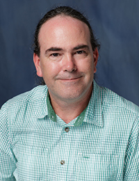 John Travis Parsons, PhD