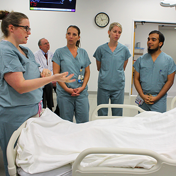 Critical care medicine fellows in a small group discussion