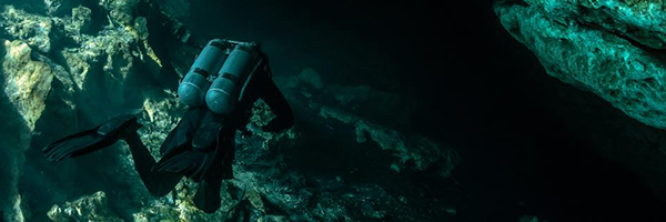 Diver going into an underwater cave
