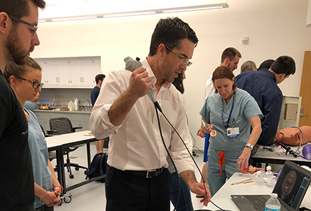 Drs. Giordano and White demonstrating simulators