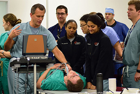 Dr. Barys Ihnatsenka demonstrates using ultrasound during Basic Skills Boot Camp